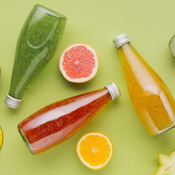 colorful-juice-bottles-fruit-slices